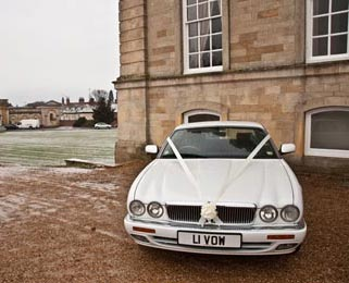 Our modern Jaguar XJ outside the wedding venue. Photo by Just-Shoot-Me Photography - http://www.just-shoot-me.co.uk