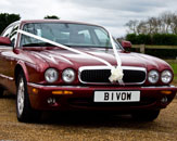 Our burgundy Jaguar XJ prepared and ready for the wedding. Photo by Just-Shoot-Me Photography - http://www.just-shoot-me.co.uk