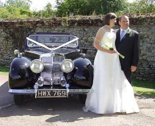 The wedding couple pose for photos next to our stunning Triumph Roadster. Photo by Just-Shoot-Me Photography - http://www.just-shoot-me.co.uk