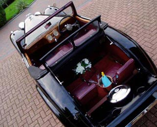 Another view into the Triumph Roadster (once more we have since removed the spare wheel, rearranged the seats and recarpeted the entire interior)