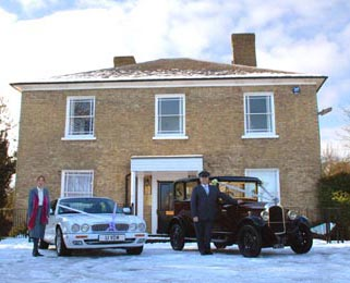 Our burgundy Vintage Citroen (Dorothy) alongside our more modern white Jaguar XJ in the snow. Photo by Just-Shoot-Me Photography - http://www.just-shoot-me.co.uk