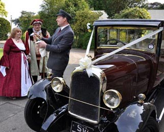 Dorothy, our burgundy Vintage Citroen, attends a wonderfully original Henry VIII themed wedding! Photo by Just-Shoot-Me Photography - http://www.just-shoot-me.co.uk