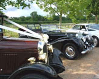 A collection of three of our wedding cars.