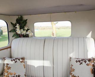 The interior has been reupholstered to the same high standard as our other vintage wedding cars Photo by Just-Shoot-Me Photography - http://www.just-shoot-me.co.uk