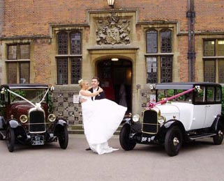 The happy couple celebrate after the ceremony with Harriet (white) and Dorothy (burgundy) 2 of our lovely vintage Citroens. Photo by Just-Shoot-Me Photography - http://www.just-shoot-me.co.uk