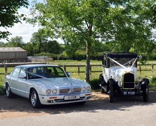 Our stunning white wedding cars - Harriet, the Vintage Citroen alongside our white Jaguar XJ. Photo by Just-Shoot-Me Photography - http://www.just-shoot-me.co.uk